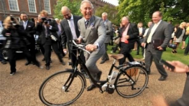 Prince Charles riding an electric bike