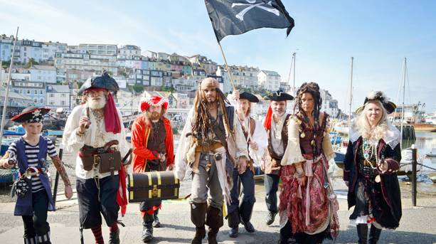 A group of people dressed in pirate costume