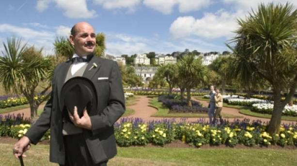 A man dressed as Hercule Poirot