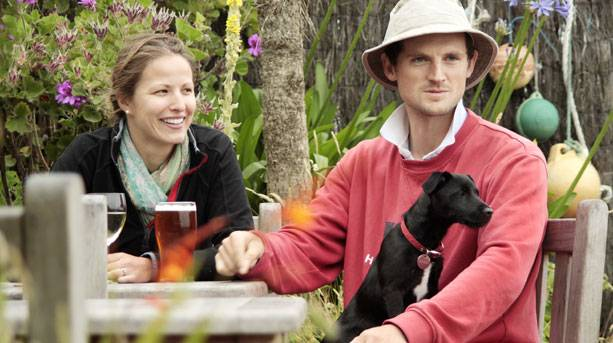 A young couple with puppy at Turk's Head