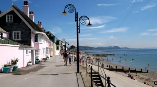 People walking along the promenade in Lyme Regis, Dorset
