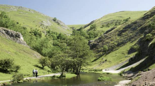 A couple walking on a footpath at Dovedale
