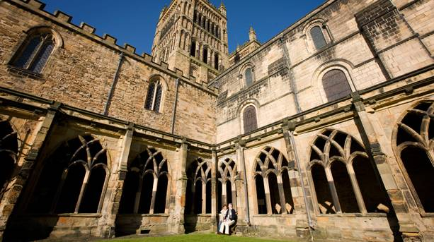 Couple relaxing at Durham Cathedral cloisters