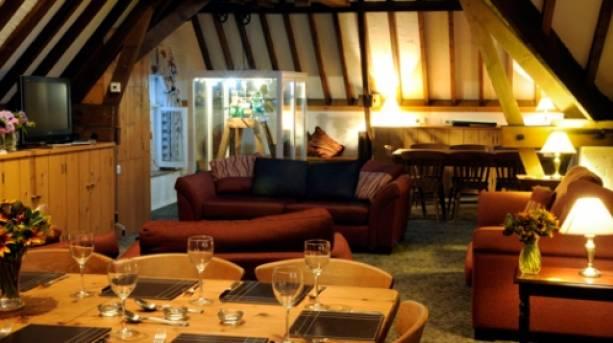 A lounge inside Brackenborough Hall Coach House
