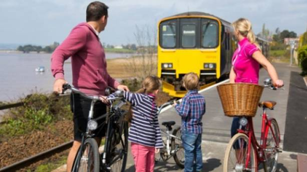 Estuary view, train stopping at Exton station- family and bikes waiting