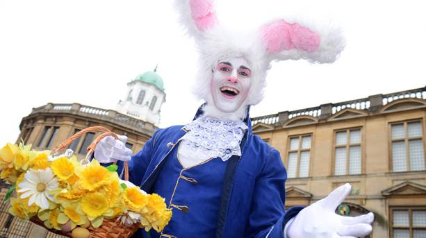 Man dressed as white rabbit in front of Oxford Sheldonian