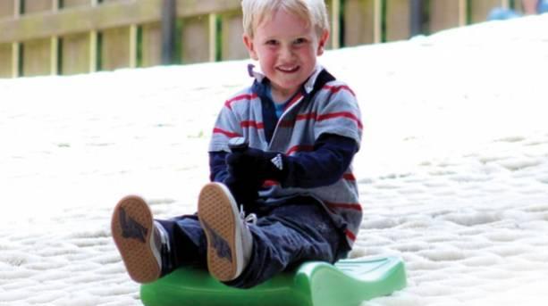 Boy sledging at Mendip Snowsport Centre, Churchill