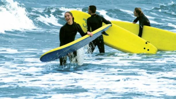 Young people enjoying surfing in the North Sea