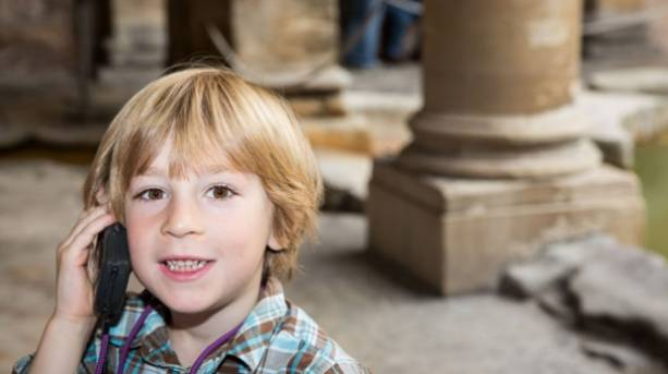 Young boy explores family attraction the Roman Baths
