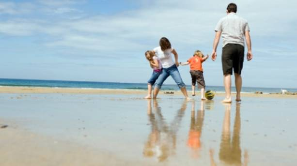 A family playing on a beach