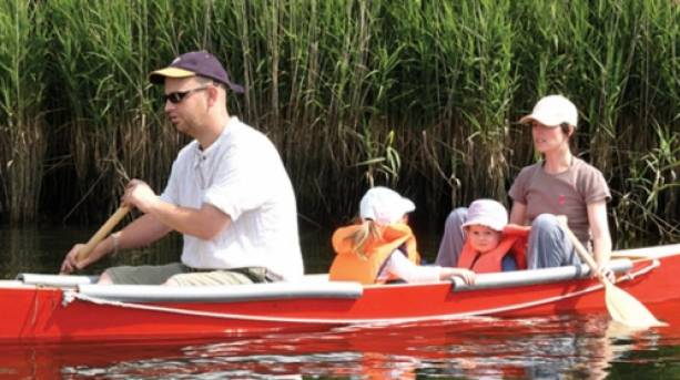 A family canoeing in the Broads