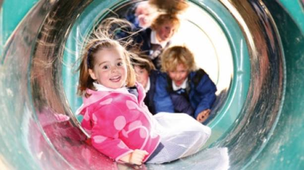 Children playing through a tube at Cannon Hall Farm