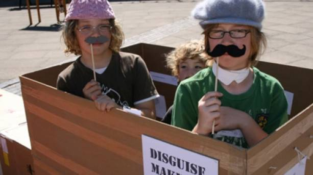 Children playing with glasses and fake moustaches