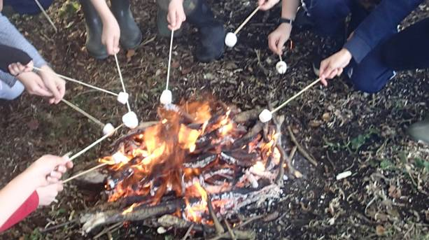 A family toasting marshmellows at Humblescough Farm, Lancashire
