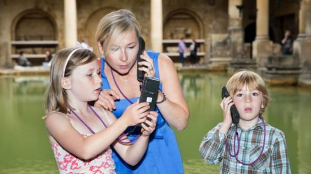 Family at the Roman Baths listening to audio guides