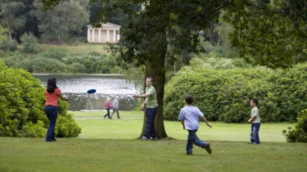 A family playing frisbe at Clumber Park
