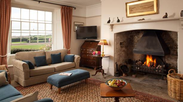 Farmhouse sitting room at Treworgey Cottages