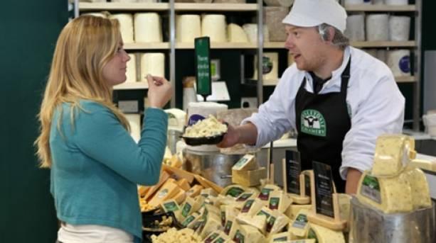 A woman sampling cheese