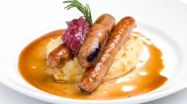 A plate of sausages and mash