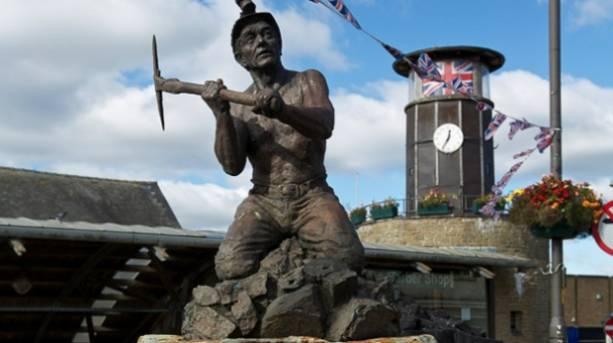 A sculpture of a miner