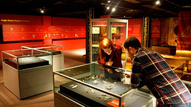 Two people at Staffordshire Hoard Exhibition at the Potteries Museum & Art Gallery