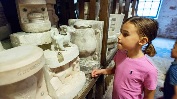 A little girl looking at pottery at Middleport Pottery