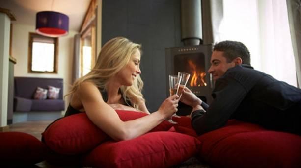 A couple enjoying a romantic evening in Cropton's Golden Oak Hideaway
