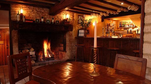 Log fire in the bar at the Green Dragon Inn