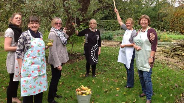 A group of women picking apples at Manor House Stables