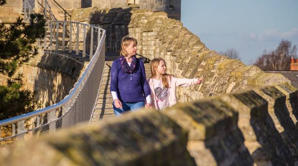 Mum and daughter walking the walls of Lincoln Castle