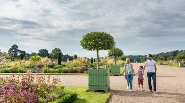 A family walking through the Trentham Italian Gardens