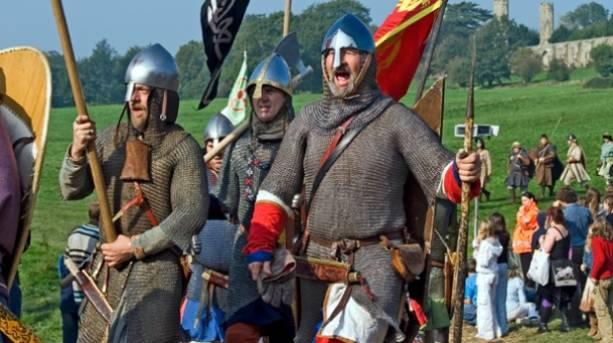 Men dressed in battle gear during a reenactment
