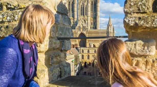 A mum and daughter looking at a view of Lincoln from Lincoln Castle walls
