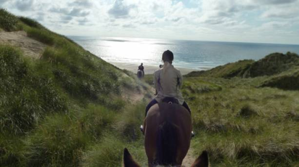 Horse riding on Perranporth beach