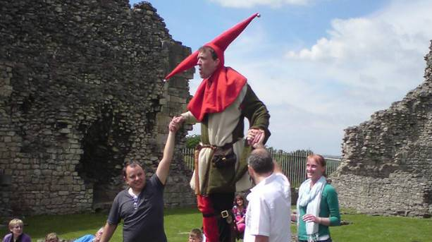 Jester amuses the crowds at a medieval event at Conisbrough Castle