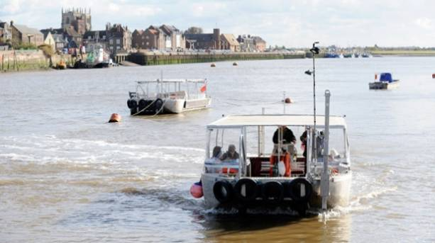 People riding the King's Lynn passenger ferry