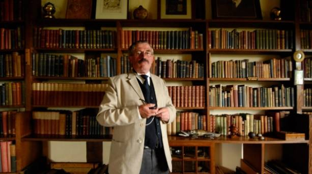 An actor dressed as Kipling in the study at Bateman's