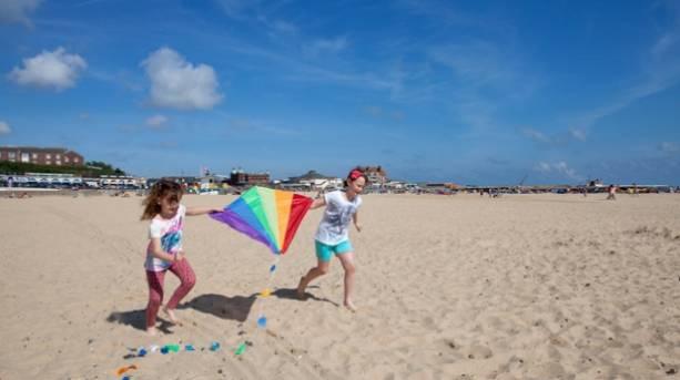 Kids playing with kites on Gorleston-on-Sea beach