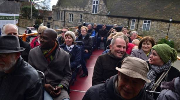 People on an open top tour bus in Lincoln