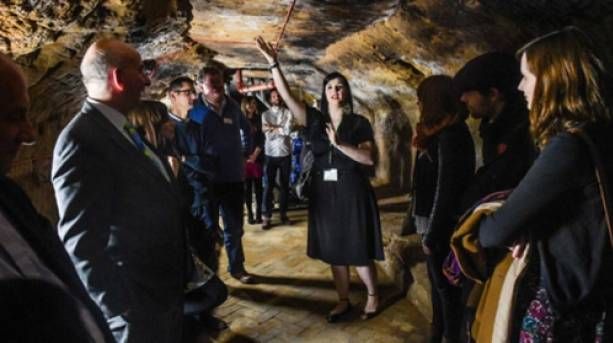 A group of people on the Malt Cross Cave Tour