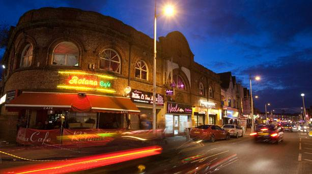 The Curry Mile' running through the centre of Rusholme in Manchester
