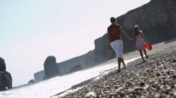 Family walking at Marsden Bay, South Tyneside
