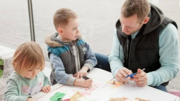 a family taking part in mima's Saturday Art Trolley