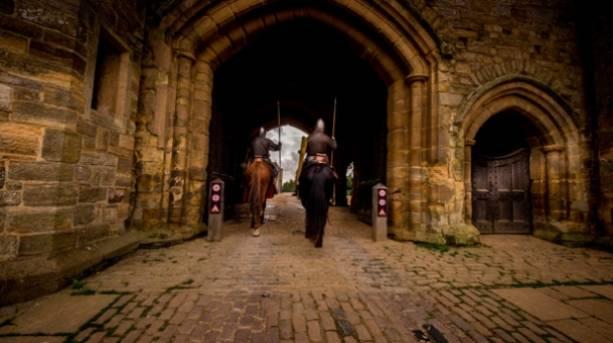 Re-enactors arrive on horseback at Battle Abbey
