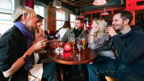 People drinking in a pub in the Northern Quarter