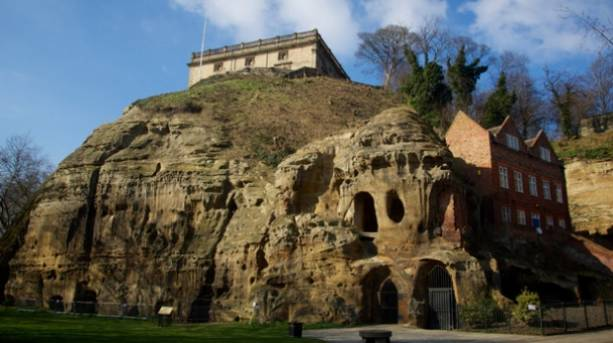Nottingham Castle sitting upon a cliff riddled with caves