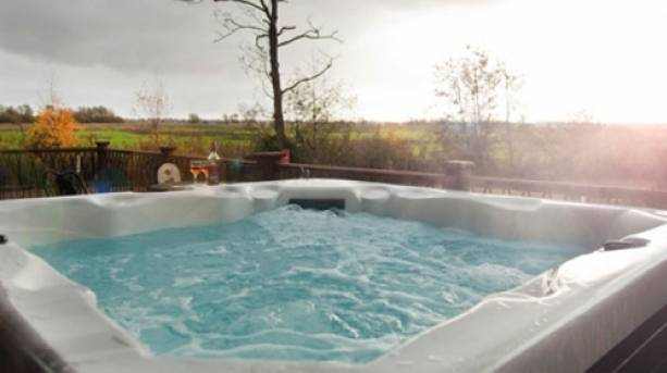 An outdoor hot tub at the Waveney River Centre