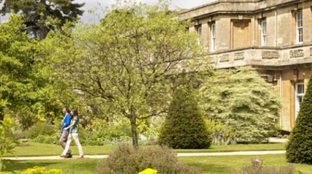 A couple walking in Oxford Botanic Gardens