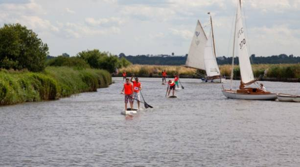 Stand up paddleboarding on the river Thurne at Martham