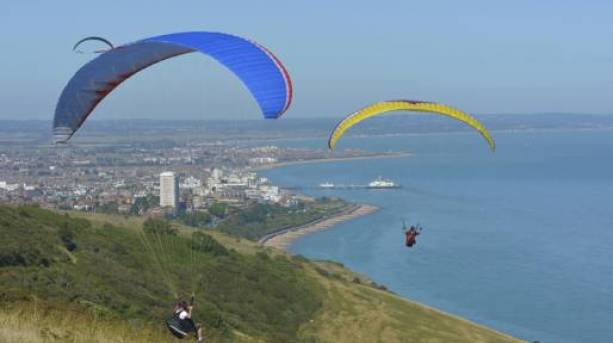 Paragliders across Eastbourne